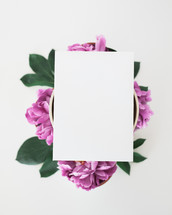 blank paper on a cup of flowers