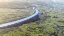 curvy road through a green mountain landscape