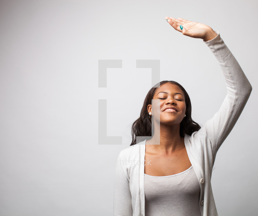Woman giving praise, raising her arm to the Lord.