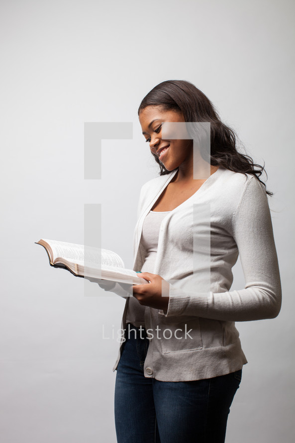 A woman reading a Bible.