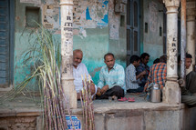 men sitting on a porch in Mandawa, India