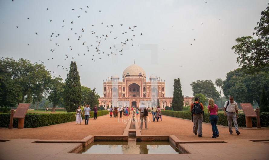 tourists at a mosque in Delhi