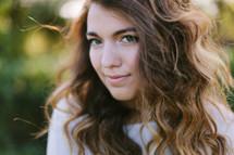 head shot of a teen girl outdoors