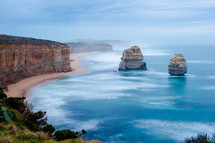 Great Ocean Road - the 12 Apostles in Victoria, Australia. Misty ocean bay with rocks.