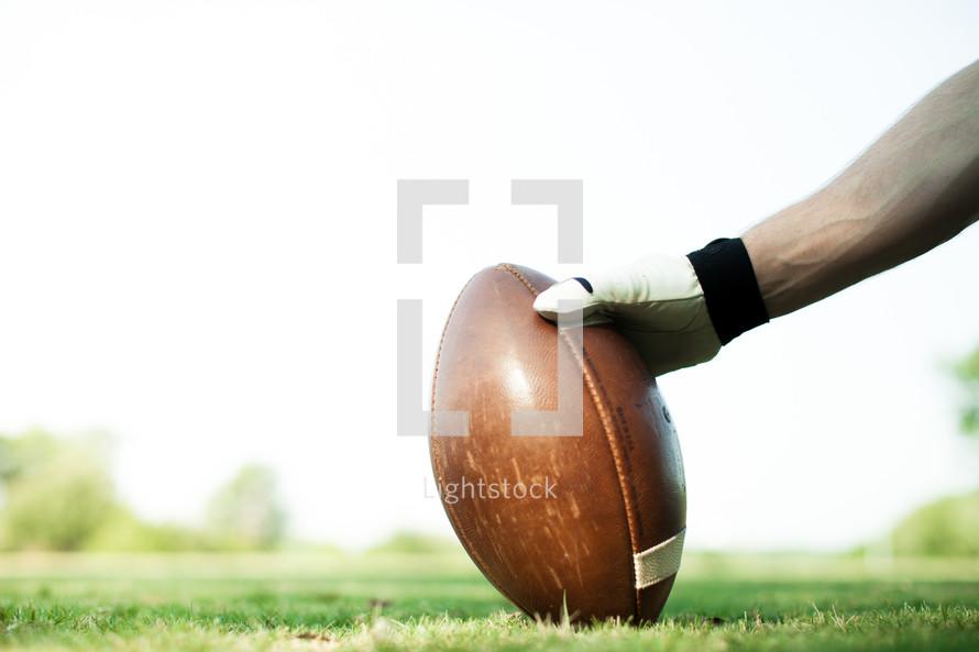 hand on a football