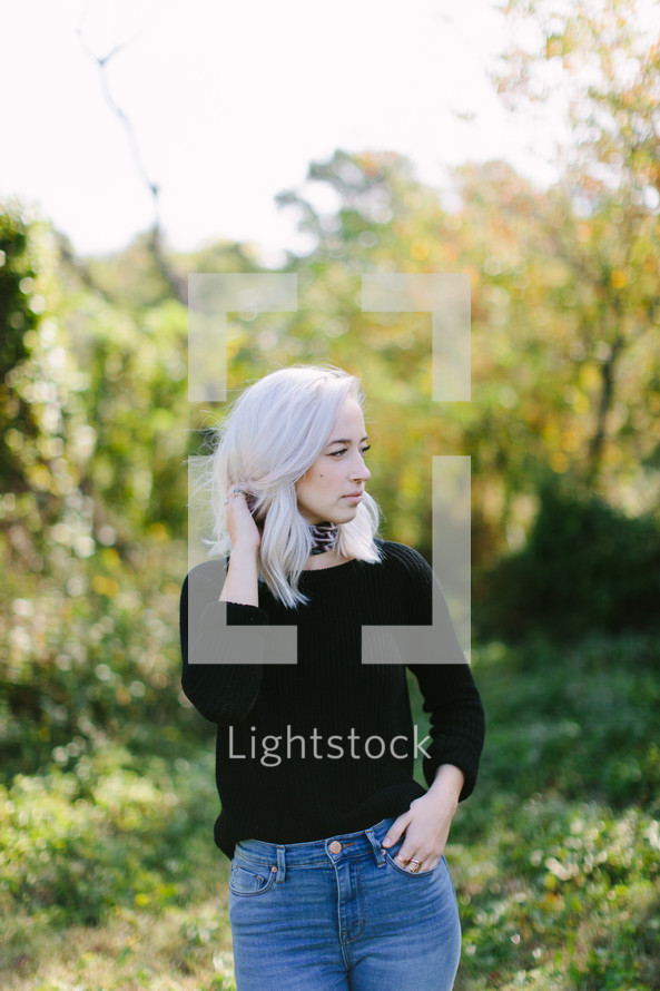 portrait of a blonde woman standing outdoors
