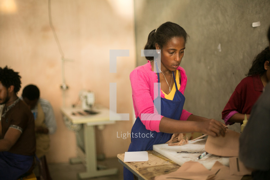 woman working in a leather cutting shop