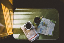 mug and map on a table in a camper
