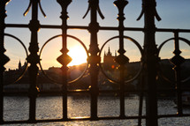 view of Prague through ornate wrought iron fencing