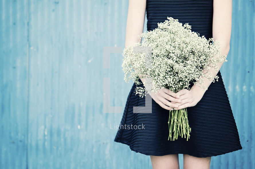 a woman holding babies breath flowers