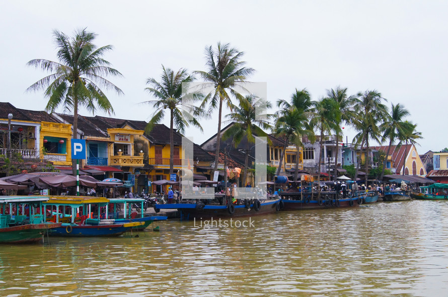 Boats line the river in town on a busy market day