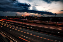 highway at dusk with storm clouds