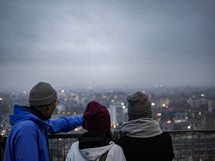 People looking out at a view over a foggy Gdansk, Poland