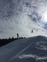 skier jumping on a slope