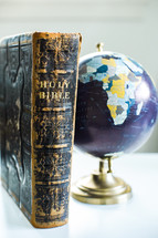 globe and Bible on a desk