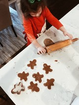 a child making Christmas cookies