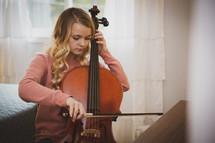 teen girl playing a cello