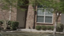 driving by houses in a neighborhood