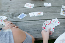 grandmother and grandson playing cards
