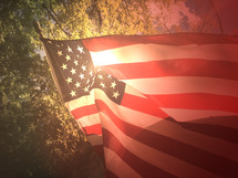 American flag and the glow of sunlight