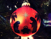 red ornament with nativity scene