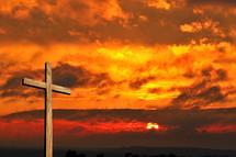 cross and a fiery sunset