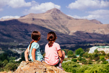 girls looking out a mountains
