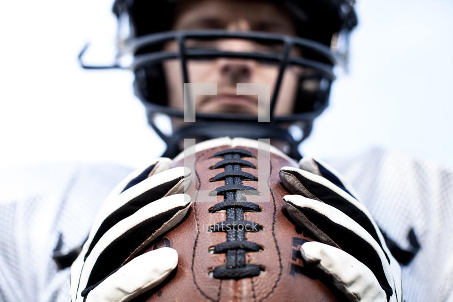 football player holding the football