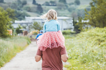 toddler girl in a tutu on father's shoulders