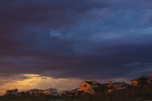 storm clouds over beach houses