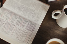 opened Bible and coffee cup