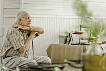 Elderly man sitting in chair