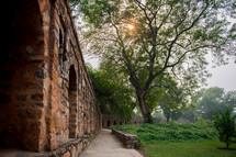 brick wall, walkway, and garden in Delhi, India