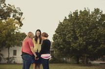 Women praying in a circle