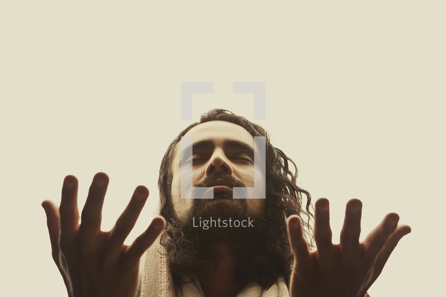 Close up of Jesus lifting his hands in prayer isolated on white