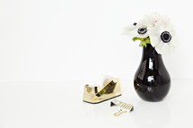 tape dispense, gold, clubs, desk, white, flowers, black centers, white background