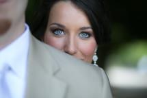 Woman looking over man's shoulder