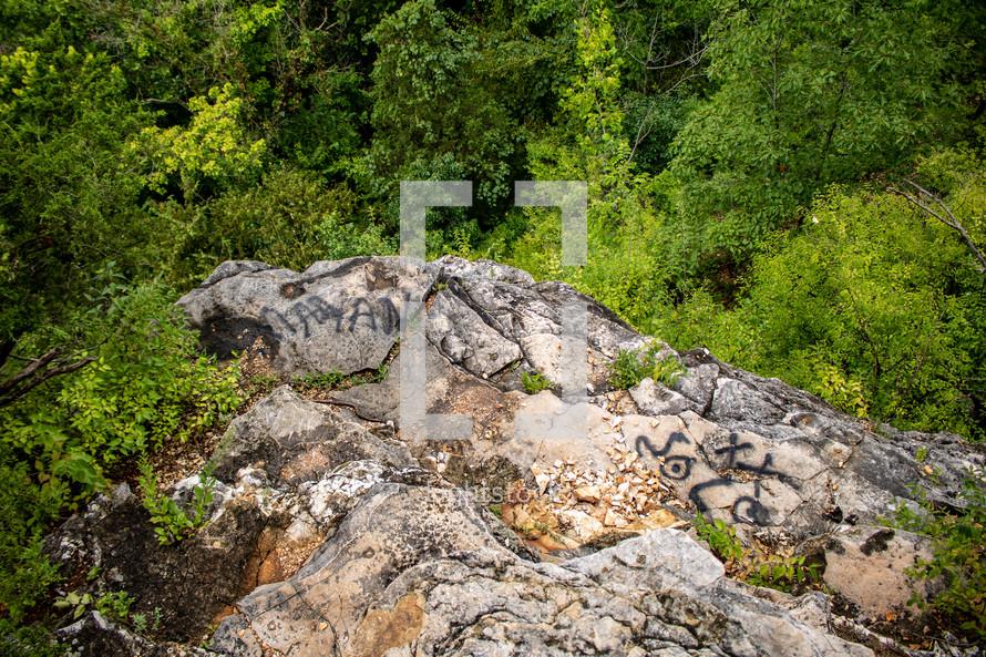 graffiti on rocks in a forest