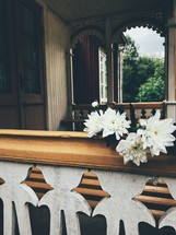 white flowers on a railing