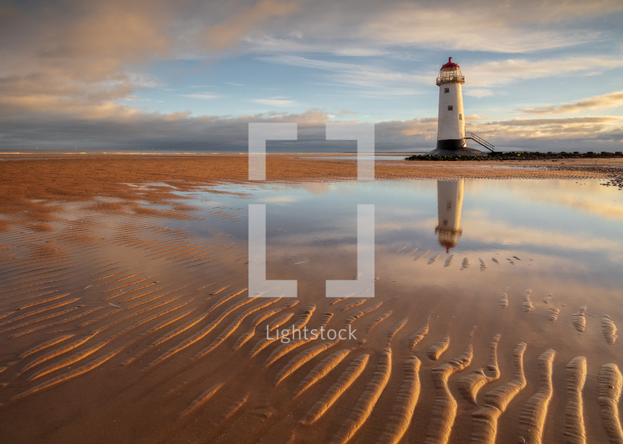 lighthouse and ripples in sand