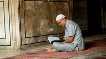 a man praying in a mosque in Delhi, India
