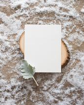 envelope on wood in snow