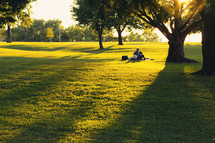 a couple enjoying a picnic in the park