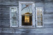 view through windows on an old farmhouse