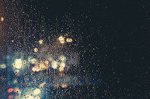 rain drops on a window and bokeh lights