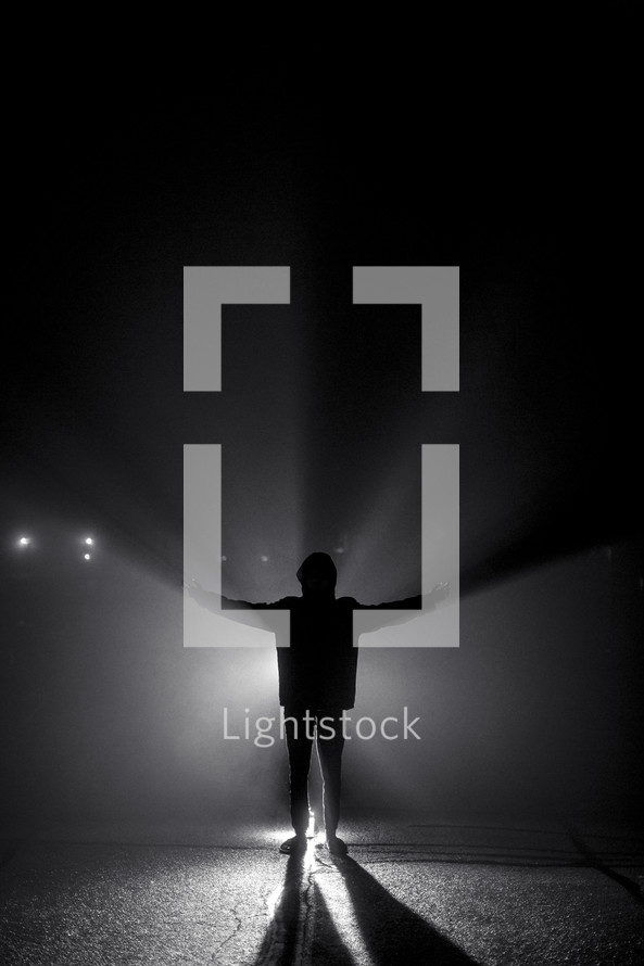 a man standing in front of glowing light