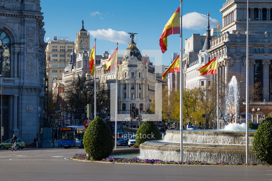 round-about and Metropolis Buildings in Madrid Spain