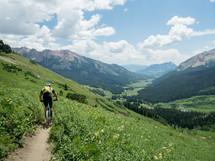 mountain biking up a trail