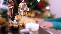 person playing a piano at Christmas and nativity scene