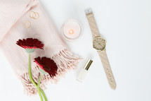 gerber daisies, watch, keychain, pink, red, rings, gold, jewelry, white background, feminine, lipstick, nail polish, winter, blush